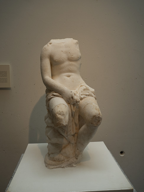 Ancient Roman sculpture missing a head
