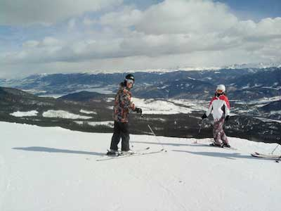 Skiers at the top of the mountain