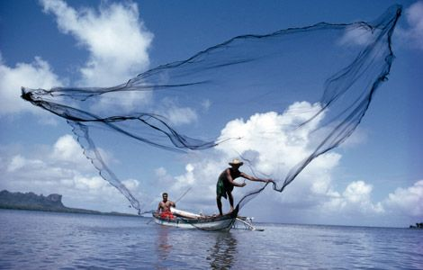 man fishing with net