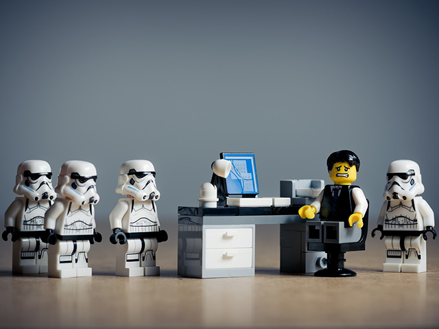 seo goals reputation management Lego man surrounded by star wars storm troopers.