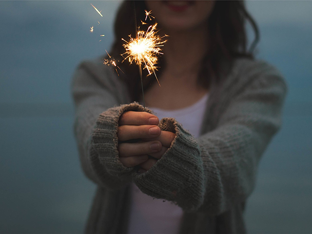 seo goals customer service Hands holding a sparkler.